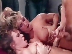 2 exposed women are playing around under the shower while a exposed guy is going through their clothes in the bedroom. When the girls come in they nearly fall over him. A little later that guy is licking one of them while the other sucks his dick.