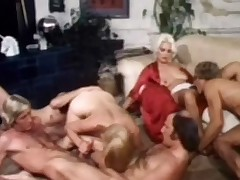 A group of four guys and two cuties are in a living room. While one of the cuties is getting her cunt licked buy one of the guys, the other girl is on the floor getting her cunt fucked while she is sucking the dick of another guy. A little later on she is fucked in the gazoo at the same time.