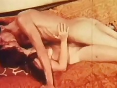 A naked couple is laying on a sofa. The guy kisses the girl all over, especially her tits. He then fucks her in her hirsute pussy, going faster and faster, making her moan with pleasure.