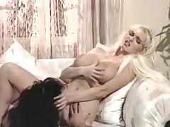 2 women, one of them a blonde, are talking to each other on a couch. The blonde girl receives up, takes her clothes off and shows her large tits. A little later she is licking the other cuties hairy pussy. After a while they change places.