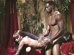 A darksome girl is fondling her naked breast while a darksome guy is watching her. That babe gets down on her knees to suck his dick. Then she goes on all fors so the guy can fuck her from behind until that guy comes all over her large tits.