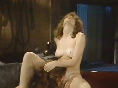2 naked brunettes are in a room. One of them is laying on a table with her legs spread wide while the other one is licking her hirsute pussy. They stop for a while to kiss each other and then the first girl lays down to get licked.