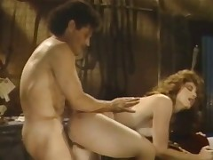 A redheaded woman is getting fucked on a bed by a muscular guy. He lifts both of her legs up so he can screw her even deeper in her curly pussy. A little later they change position and he gets fucked from behind.