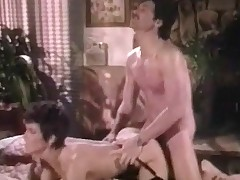 A girl is lying on the bed complaining about a abdomen ache. The guy who is sitting next to her suggests to heal her and when this babe allows him to he lifts up her skirt and licks her pussy. After this babe blows his dick he fucks her from behind.