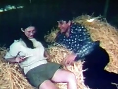 A couple is laying in the haystack in a barn. The chap is touching the girl up, licking her tits. Then she gives him a blow job until the farmer and his wife come in. At first they are angry but they end up in a foursome.