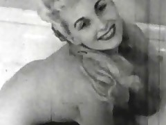 A blonde girl is in the bathroom. She is totally bare and fills up the bathroom while she is swaying her body, showing her firm tits. When the bathroom is full she steps into the water and plays with the suds.