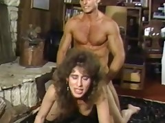 A naked girl is getting fucked on the floor in front of a fireplace by an athletic guy. He screws her so hard that her tits are swaying about. She then goes down on her knees so this chab can fuck her from behind.