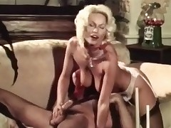 A blonde cutie and a guy are on a couch exchanging French kisses. That babe slips out of her clothes and then she gets down on her knees in order to blow him, straddling his face to be licked. A little later she lowers her pussy over his cock.