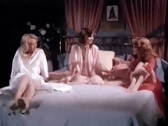Three girls in night gowns are sitting on a bed, talking to each other. Two of them begin to make love with one some other while the third one watches them. Lastly she takes her clothes off and joins in, having her tits and her pussy licked.