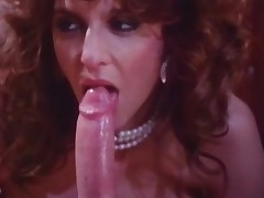 A guy and a cutie are sitting next to every other talking. They start kissing and a little later they are naked, cuddling up to every other. Then the cutie starts to suck the studs biggest dick, making it vanish all the way into her throat.