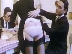A pair of Italian gangsters are talking to each other at the kitchen table. On of the guys is rubbing feet with the girl sitting next to him. A little later a maid brings in the soup. When she bends over, one of the guys lifts her suit and sticks his f