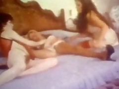 A woman is laying on the bed wearing only her nightgown. Between her spread legs is a young girl licking her pussy. A 3rd girl, who has been watching all the time, approaches the bed and strokes the other girls before joining in.
