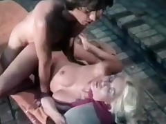 A naked golden-haired girl is in an outdoor Jaccuzzi. She is leaning back whilst a guy is eating her pussy. The she sucks his dick for a lengthy time before laying down on a lounge, psreading her legs. The guy climbs on top of her in order to fuck her.