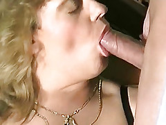 Blond girl lying on the floor with a guy fucking