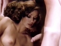 A couple is dancing together and the girl is stroking the guy's crotch. A little later they are both naked and this babe is sucking his dick. A little later this babe is sitting opposite him, masturbating. Then the guy goes on his knees and licks her pussy.
