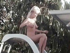 Two sexy looking beauties approach a guy who is asleep next to the swimming pool. One of them wakes him up by shoving her pussy in his face but the other has put some handcuffs on his stiff dick. At 1st they throw him in the water but then both beauties end u