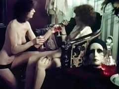 In this vintage film we follow and American tourist who visits Amsterdam in the sixties. She ends up half naked in a room with another girl who is only wearing panties. The girl seduces her and a little later her hairy pussy is being licked.