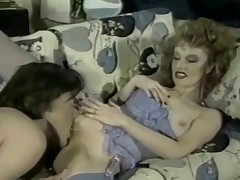 A woman in lingerie and a guy are in the living room. She lays down on the couch while this guy takes his garments off. Squeezing her marangos she shows him her shaved pussy which this guy licks for a while before fucking the girl from behind.