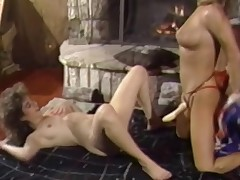 A naked angel is laying on her back on the floor. In between her knees some other angel who is wearing a strap on vibrator kneels down. She licks the 1st girls pussy for a while. The the 1st angel goes down on all fours to have her pussy licked again.