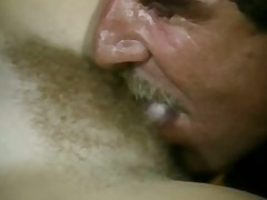 A blonde gal is laying asleep on a mattress on the floor. There is a dude sitting next to her who begins to lick her pussy. Spreading her legs gently he digs his tong in deeper and deeper until the gal wakes up.