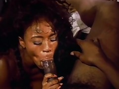 Dark skinned cutie enjoys the wild interracial threesome in the office
