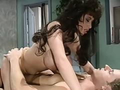 Big breasted brunette blows and bonks a long shaft all over the bed