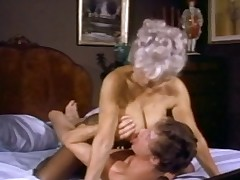 Hot mature with good pantoons gets drilled by John Holmes and his legendary cock