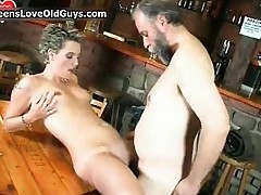 Naughty blonde is sat on a chair rubbing