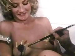 A young woman with large tits is undressing in the bathroom during the time that another girl is watching her. A guy enters and begins to paint their tits. A little later the 3 of them move to the living room where they fuck on the floor.