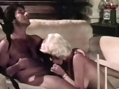 A blonde woman leads a stud into her newly renovated living room. She undresses slowly and then goes down on her knees to suck his dick. The both of them end up fucking on the floor until the guy comes in her mouth.