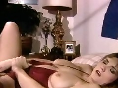 A woman in bikini is laying on a bed. She pulls her panties aside and plays with her hairy pussy. She pulls her brassiere down and massages her nipples too. Then she ficnger fucks herself until she comes.