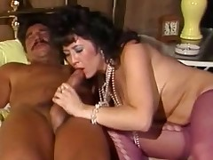 A woman who is wearing nothing but darksome stockings is getting fucked by a fellow on a bed. She is teling him in a loud voice to fuck harder. When he finally pulles back she gives him a blow job.