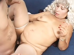 Chunky mature lady in white stocking copulates the young stud's hard dick with fervor